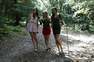 3 young girls walking in the..