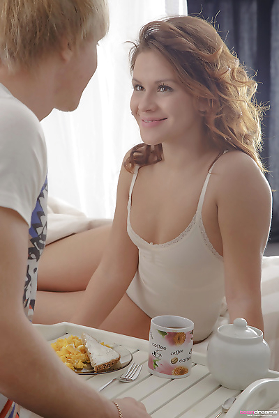 Young redhead seduces her..