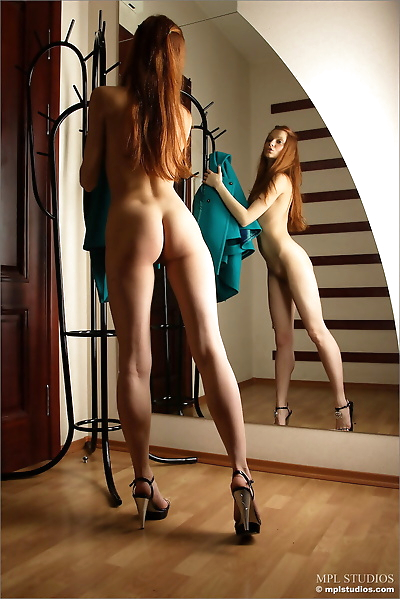 Pale redhead admires her..