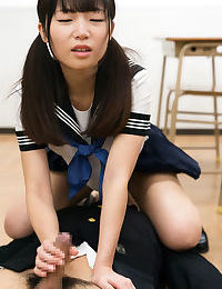 Japanese schoolgirl in pigtails facesits & gives teacher a handjob in class