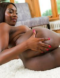 Ebony wife Jai James stripping in the room while shaking her big tits