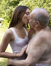 Flat chested young girl gets on her knees in the street give oldman POV blowy