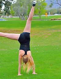 Blonde sports girl flashes closeup pussy in public & squats nude in the grass
