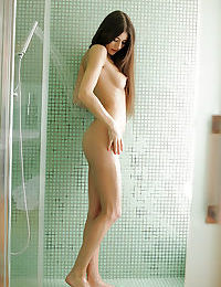 Nessa Shine taking a shower and playing with her trimmed pussy