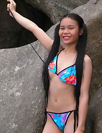 Delicious 18 year old Asian girl gets naked at the beach & shows her hot body