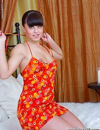 Full-figured teen stripping on the bed and exposing her bare feet
