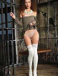 Skinny teen bird Cualy strips her skirt & panties on the swing in her cage
