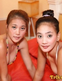 Filipino sisters April and May takes off their bikinis at the same time