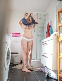 Lesbians Rose K- Layla K show natural tits while dressing in the laundry room