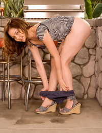 Barely legal teen Jewel Styles undresses while attending to the BBQ